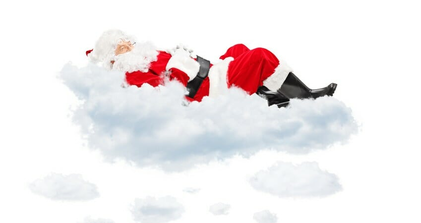 Santa Claus resting while lying on cloud